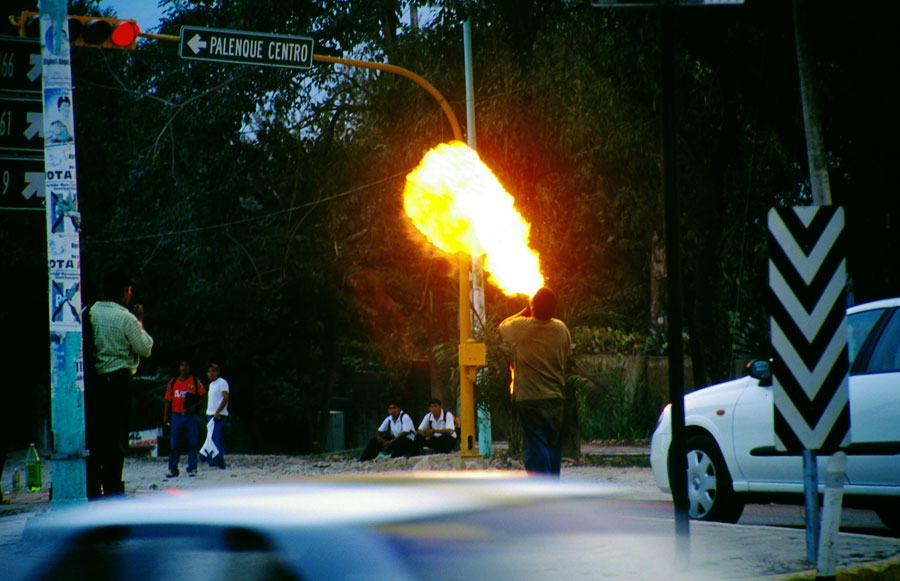 A novel way to earn a buck; firebreather at traffic lights in Palenque (Day 201)