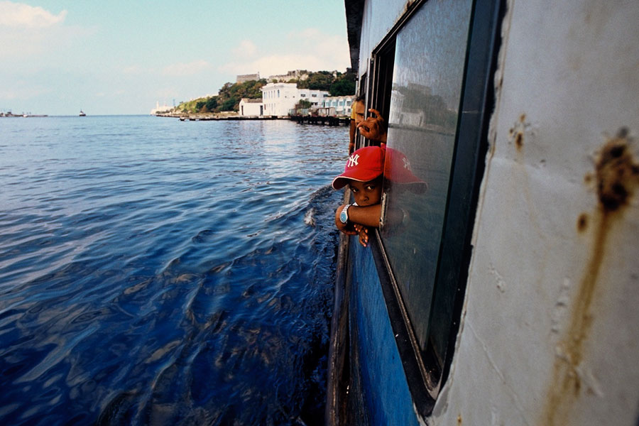 Ferry boat from Havana, boy in baseball cap