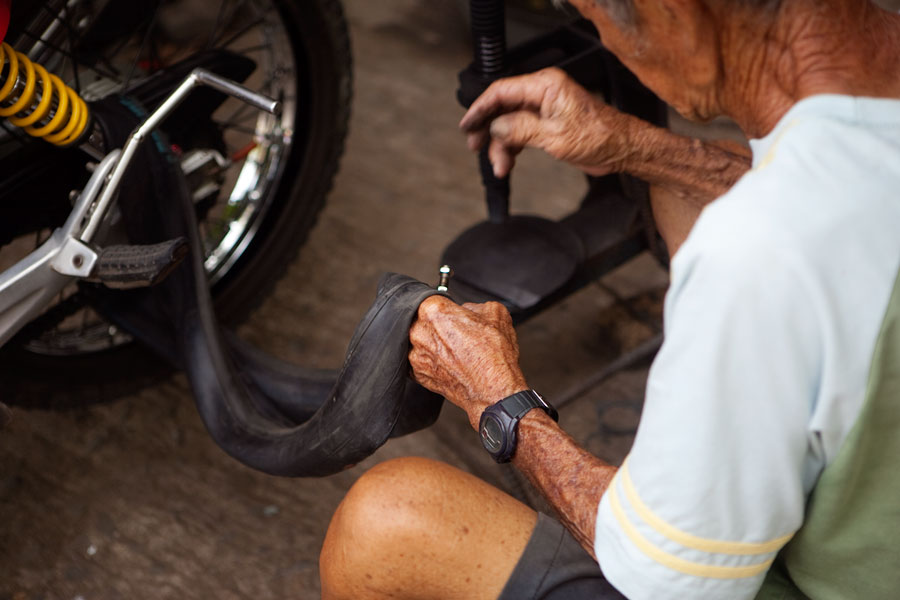 Motorcycle tyre repair, Camaguin travel photography