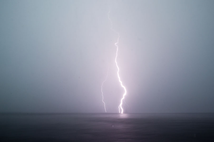 Lightning hitting the ocean, Angola
