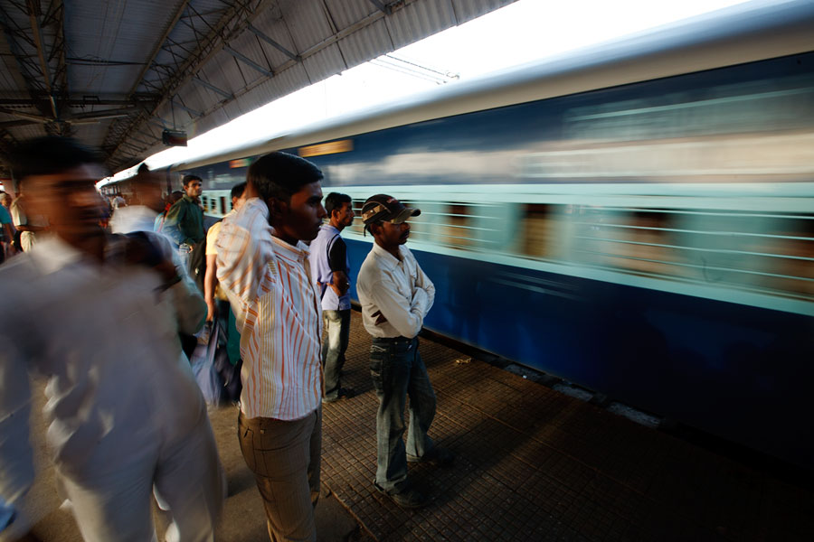 Delhi train station with train arriving