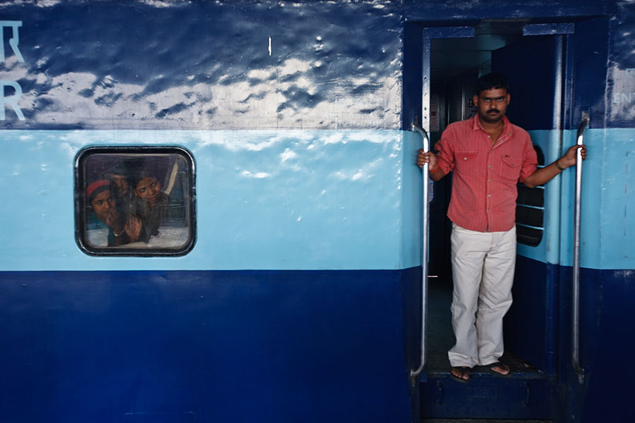 Man at door of train, India