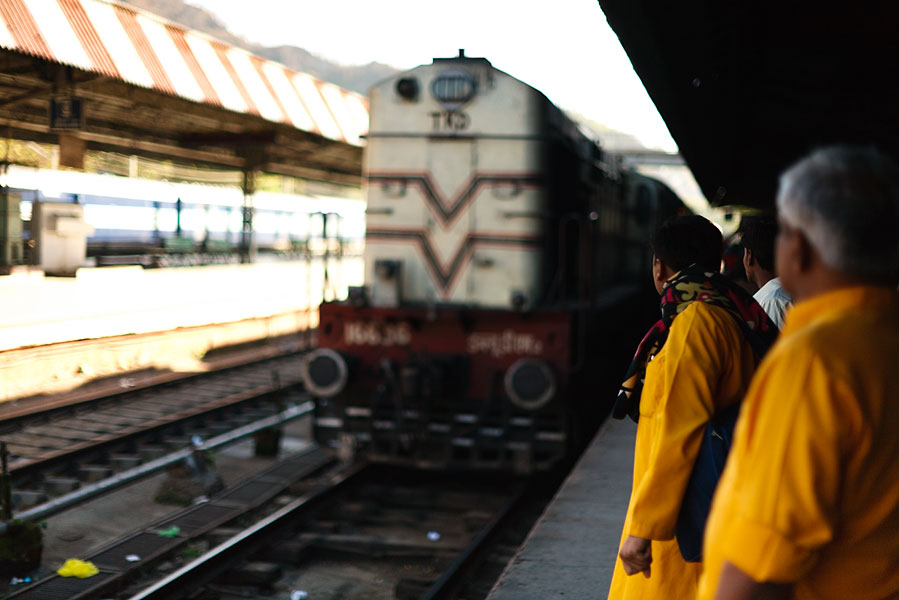Locomotive arriving at train station, India