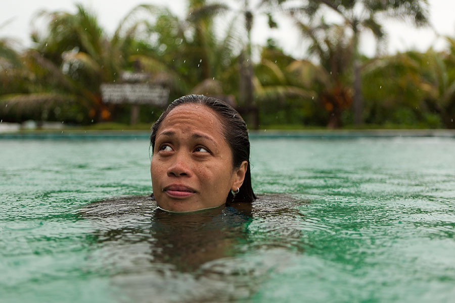Monica in the Kapuluan Vista Resort pool during a rainstorm