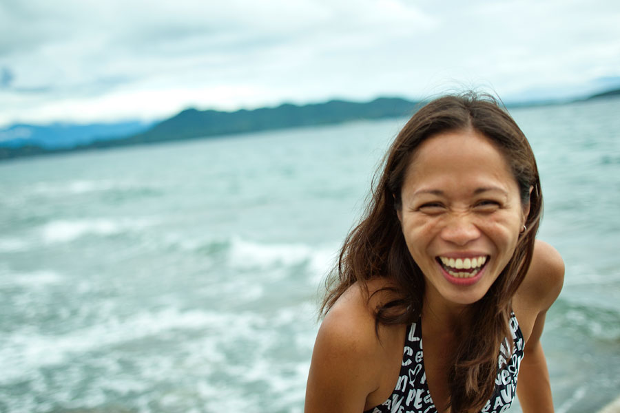 Monica laughing on the beachfront, Mayumi Dive Resort, Anilao, Batangas, Philippines