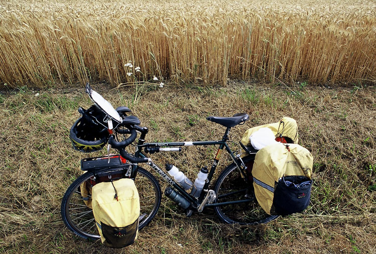 Touring bike beside wheat field in France