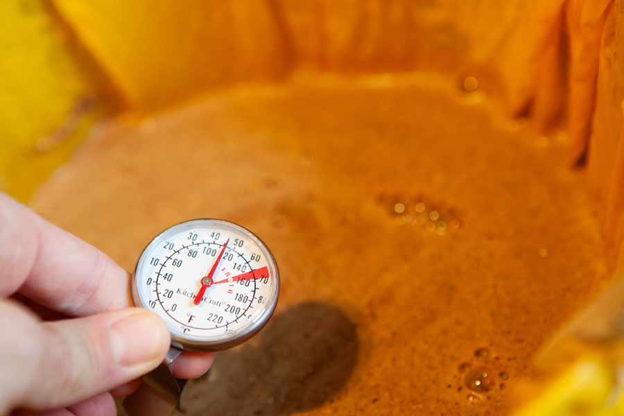 Gluten free homebrew beer checking the wort temperature